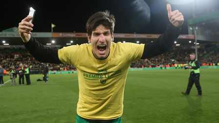 Timm Klose of Norwich celebrates promotion at the end of the Sky Bet Championship match at Carrow Ro