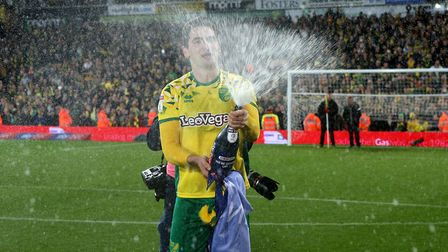Kenny McLean of Norwich celebrates promotion at the end of the Sky Bet Championship match at Carrow