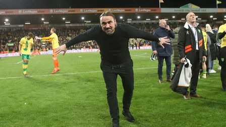 Norwich Head Coach Daniel Farke celebrates promotion with the South Stand at the end of the Sky Bet