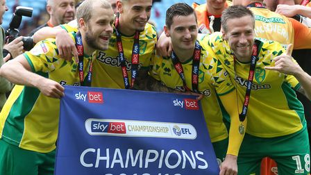 Teemu Pukki, Ben Godfrey, Kenny McLean and Marco Stiepermann of Norwich at the end of the Sky Bet Ch