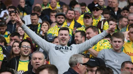 The traveling Norwich fans celebrate winning the Championship at the end of the Sky Bet Championship
