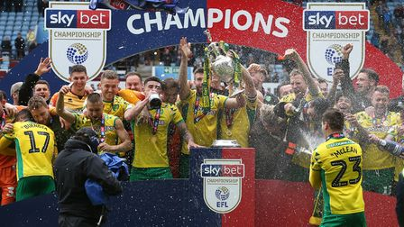 The Norwich players celebrate winning the Championship at the end of the Sky Bet Championship match
