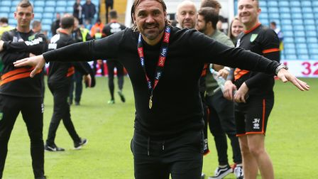 Norwich Head Coach Daniel Farke celebrates with the traveling fans at the end of the Sky Bet Champio
