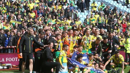 City players poses for a photo in front of the travelling Norwich fans