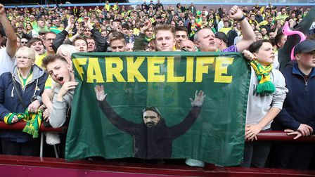 The traveling Norwich fans celebrate at the end of the Sky Bet Championship match at Villa Park, Bir
