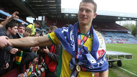 Christoph Zimmermann of Norwich celebrates winning the championship with the traveling Norwich fans