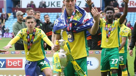 Christoph Zimmermann leads the Norwich City celebrations with the Football League Championship troph