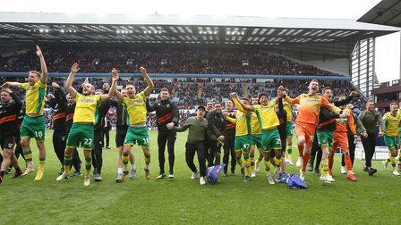 The Norwich City players celebrate in front of the travelling fans, as they clinch the Championship