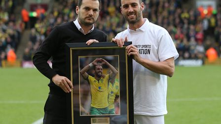 Norwich City sporting director Stuart Webber presented Ivo Pinto with a framed photo ahead of the Te