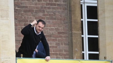 Norwich Citys sporting director Stuart Webber celebrating promotion on the balcony at City Hall Pict