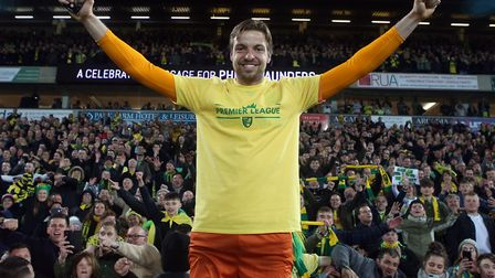 Tim Krul celebrates promotion with Norwich City fans in the Barclay Stand after beating Blackburn Pi