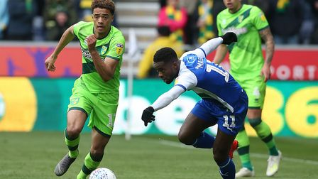 Jamal Lewis shows Gavin Massey a clean pair of heels during Norwich City's draw at Wigan Athletic. P