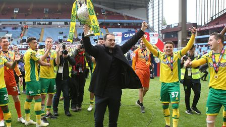 Norwich City sporting director Stuart Webber lifts the Football League trophy at Villa Park. Picture