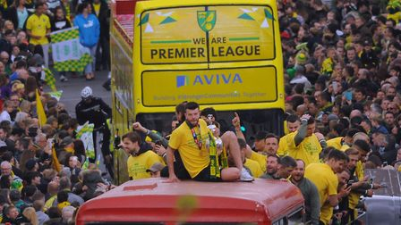 Norwich City footballers welcomed their Premier League promotion with open arms - and an open-top bu