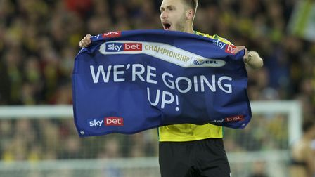 The banner says it all, as Tom Trybull celebrates Norwich City's Premier League return following vic