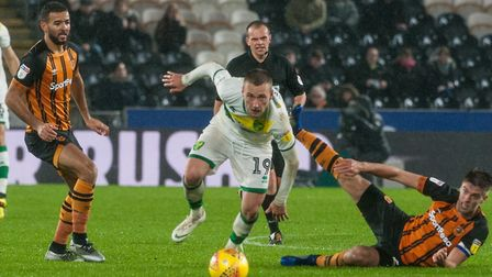 Tom Trybull evades a tackle from Hull defender Markus Henriksen, on his return to Norwich City's sta