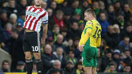 Billy Sharp and Tom Trybull rise for the ball during Norwich City's 2-2 draw with Sheffield United,