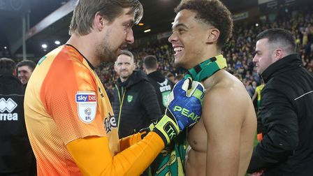 Jamal Lewis of Norwich and Tim Krul of Norwich celebrate promotion at the end of the Sky Bet Champio