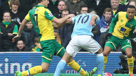 Timm Klose tackles Manchester City star Sergio Aguero during the Canaries' 0-0 home draw in the Prem
