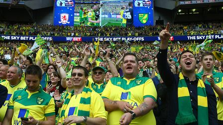 The Norwich fans celebrate victory at the end of the Sky Bet Championship Play-off Final at Wembley