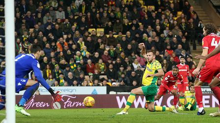 Onel Hernandez's cross is heading into the back of the net, to reduce Norwich City's arrears in a dr