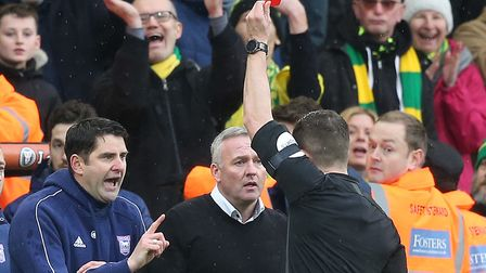 The trial of yellow and red cards for coaching staff is being made permanent throughout football Pic