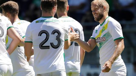 Kenny McLean celebrates a Teemu Pukki goal with the man himself, as Norwich City beat Paderborn in p