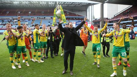 Wanted man? Norwich City sporting director Stuart Webber with the trophy at the end match at Villa P
