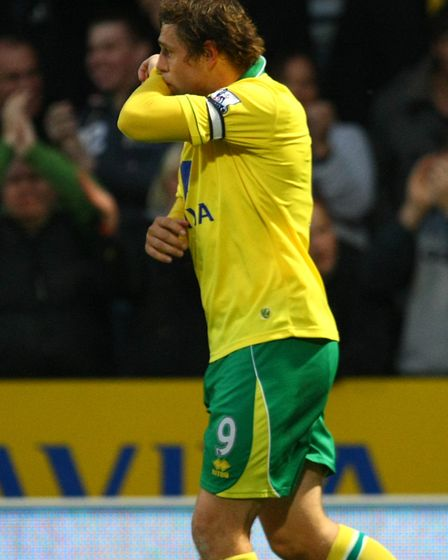 Grant Holt celebrates after scoring the only goal of the game when City met Arsenal at Carrow Road i