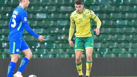 Simon Power in action for Norwich City U23s at Carrow Road against Wolfsburg II earlier this season