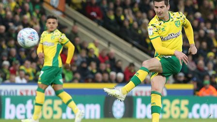 Kenny McLean is with the Scotland squad, after playing a key role in Norwich City's promotion to the