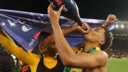 Max Aarons and Jamal Lewis toast Norwich City's promotion back to the Premier League at Carrow Road.