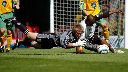 Robert Green tangles with Fulham's Luis Boa Morte at Craven Cottage in 2005 Picture: Archant