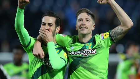 Mario Vrancic and Marco Stiepermann, right, celebrate the Canaries' win at Blackburn just before Chr