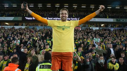 Tim Krul of Norwich celebrates promotion with the Barclay End at the end of the Sky Bet Championship
