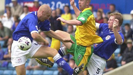 Iwan Roberts in action on a tough opening day at Millwall in 2001 Picture: Archant