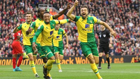 Russell Martin celebrates scoring for Norwich the last time City played at Anfield. It ended 1-1 - w