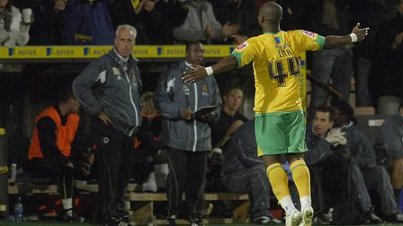 Leroy Lita celebrates as Wolves manager Mick McCarthy looks on Picture: Archant