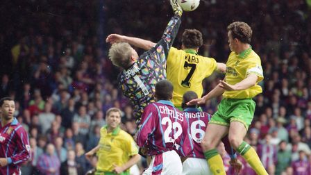Ashley Ward and Jon Newsome rise for a corner, during Norwich City's final game of the 1994-95 Premi