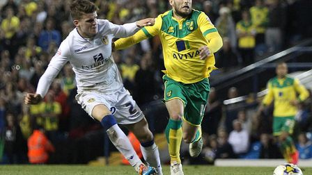 Sam Byram in action for Leeds in April 2015, chasing Norwich City favourite Wes Hoolahan during a 2-