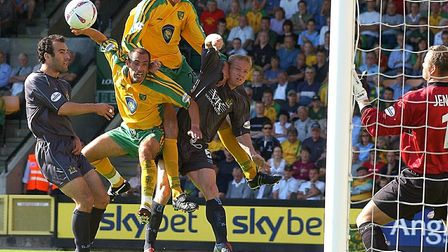 Peter Crouch climbing above team-mate Craig Fleming during a game against Burnley at Carrow Road Pic