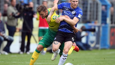 Dennis Srbeny, left, scored a fine equaliser for Norwich against Arminia Bielefeld Picture: Paul Che