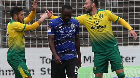 Josip Drmic is congratulated by Emi Buendia after scoring his penalty against Arminia Bielefeld Pict