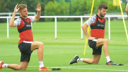 Norwich City football team training at Colney. Dennis Srbeny, left, and Grant Hanley. Picture: DENIS