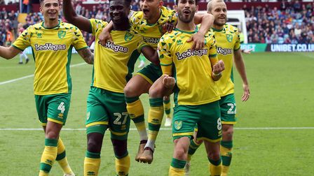 Mario Vrancic leads the celebrations, having scored the goal that sealed Norwich City's Championship