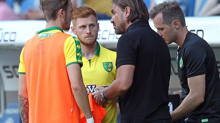 Head coach Daniel Farke talks to James Maddison and Harrison Reed during Norwich City's 3-1 friendly