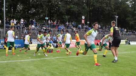 The Norwich players warm up before the Pre-season friendly match at Energieversum Stadion, Gutersloh