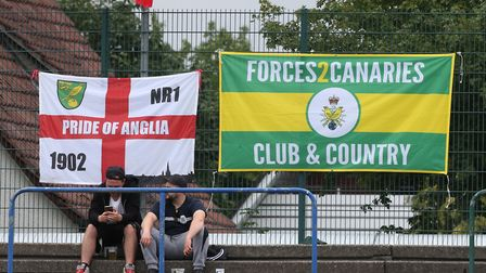 The travelling Norwich fans put their flags up before the pre-season friendly match at Energieversum