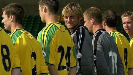 Robert Green and Iwan Roberts find something of interest, as Norwich City line up for their 2003-04