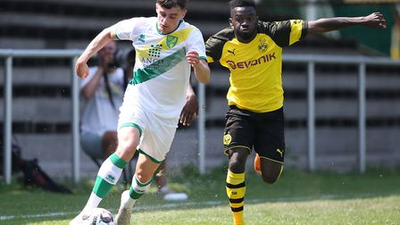 Norwich City U23 winger Simon Power takes on his opposite number against Borussia Dortmund in pre-se